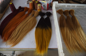 Vendors in Taihe, in the east of China, display their selection of hair at a street market. The county made £52 million from exports in 2012 - nearly half of its total